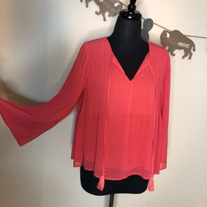 Coral accordion blouse